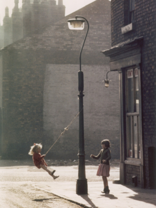 shirley-baker-two-girls-swing-on-a-lampost-manchester-1965_i-G-46-4606-W8CFG00Z
